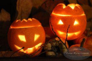 Подсвечник со злой или забавной рожицей из апельсина на Хэллоуин
