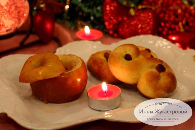 Булочки с шафраном и изюмом в виде крендельков на день Святой Люсии